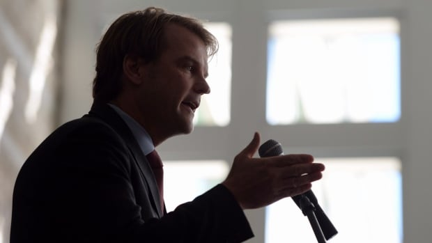 Conservative candidate Chris Alexander, seen here speaking as immigration minister on World Refugee Day in 2014, is under fire for Canada's response to the humanitarian crisis of refugees fleeing Syria.