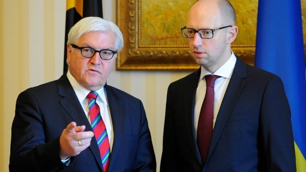 German Foreign Minister Frank-Walter Steinmeier, left, met with Ukrainian Prime Minister Arseniy Yatsenyuk on Wednesday ahead of the signing of a Ukraine-EU trade deal.