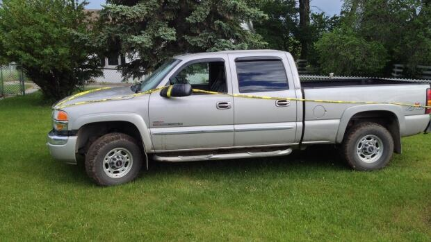 The driver of this truck stolen near Balzac is in hospital with serious, life-threatening injuries.
