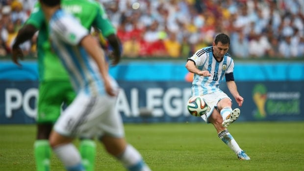Lionel Messi, right, of Argentina scores his second goal in the match against Nigeria at the 2014 FIFA World Cup.
