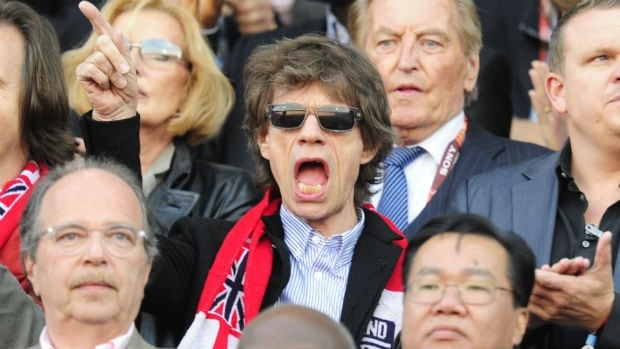 Mick Jagger reacts to something that happened in the England-Germany World Cup Round of 16 match in 2010. It was probably something bad because England lost 4-1.