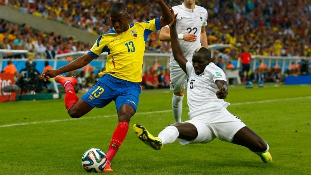 Enner Valencia of Ecuador, left, is challenged by Mamadou Sakho of France during the teams' clash at the 2014 FIFA World Cup.