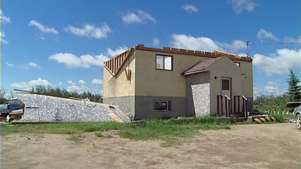 A roof was torn off a home on the Kawacatoose First Nation in Saskatchewan after a tornado struck in 2010.