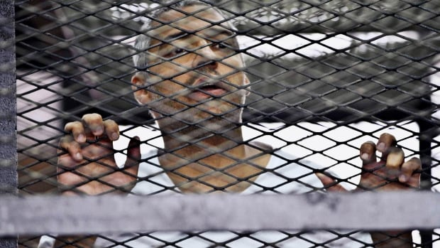 Mohammed Fahmy, Canadian-Egyptian acting bureau chief of Al-Jazeera, is one of three journalists sentenced to seven years in prison on terrorism-related charges after a trial dismissed by rights groups as a politically motivated sham.