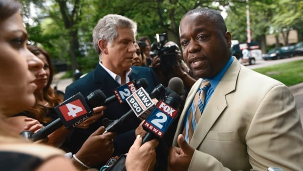 Charlie Bothuell IV speaks to the media after finding out that his son, Charlie Bothuell V, was found alive in the basement of his home in Detroit on Wednesday.
