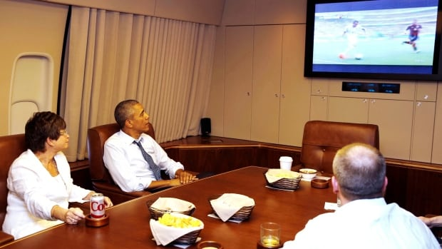 U.S. President Barack Obama, on Air Force One, catches part of the Americans' match against Germany at the FIFA World Cup.