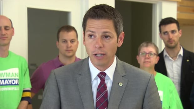 Mayoral candidate Brian Bowman speaks to reporters about his open data promise during a campaign event on Thursday.