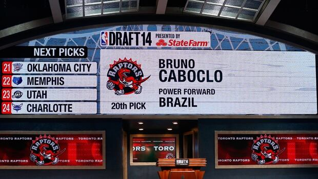 A video screen shows Toronto's selection of absent prospect Bruno Caboclo as the No. 20 pick in the NBA draft on Thursday.