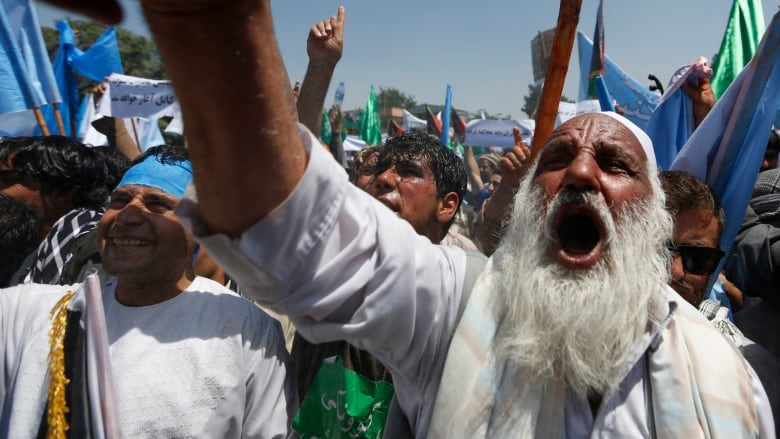 Afghan election: Thousands of protesters march on