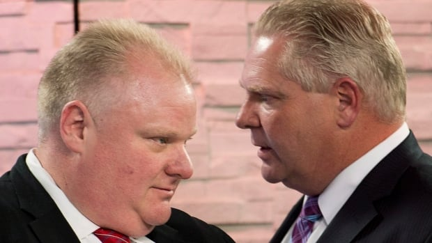 Doug Ford, right, says he's keen to step in and serve as an unofficial Toronto council member while his brother, Rob Ford, recovers from surgery to remove a malignant tumour.
