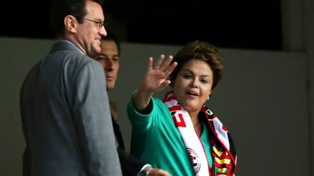 Brazilian President Dilma Rousseff is seen here waving as she visited Arena da Baixada stadium prior to the start of the World Cup. Police said Friday an officer asked permission to fire on an armed man approaching the president at the opening ceremony of the World Cup.