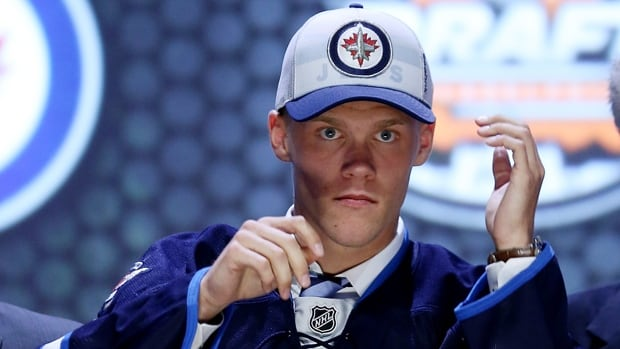 Nikolaj Ehlers adjusts his ballcap after being selected ninth overall by the Winnipeg Jets at NHL draft in Philadelphia on Friday.