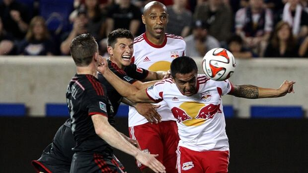 New York midfielder Tim Cahill (17) eludes two defenders to head the ball in Friday's 2-2 draw with Toronto at Red Bull Arena.