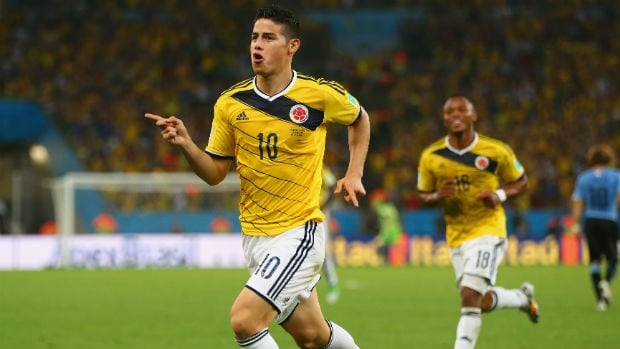James Rodriguez of Colombia celebrates his first of two goals against Uruguay in the teams' Round of 16 match at the FIFA World Cup.