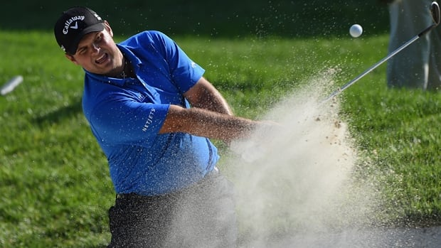Patrick Reed hits out of a bunker on the 17th hole in the Quicken Loans National at Congressional Country Club on Saturday.