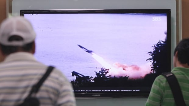 South Koreans watch a TV news program showing the missile launch conducted by North Korea in Seoul on Sunday, June 29, 2014. North Korea fired two short-range missiles into its eastern waters Sunday.