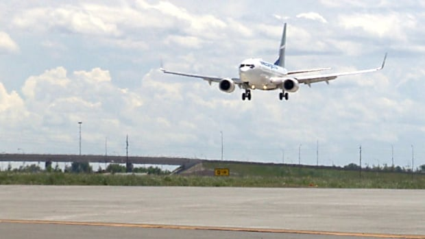 A WestJet flight from St. John's, Nfld., was the first to use the new Calgary runway when it opened Saturday after three years of construction.
