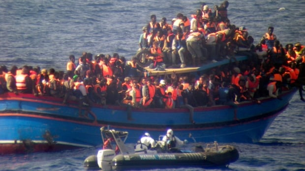 The bodies of some 30 would-be migrants were found in in the hold of a packed smugglers' boat making its way to Italy, the Italian navy said Monday. The boat was carrying nearly 600 people, and the remaining 566 survivors were rescued by the Italian navy frigate Grecale.
