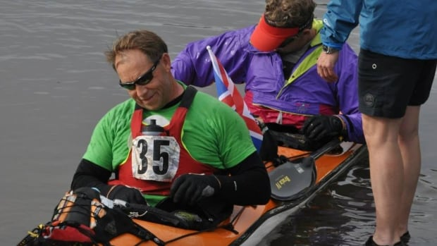 """U.K. tandem kayakers """"Two Numbnuts"""" were the first to reach the finish line at Dawson City in the 2014 Yukon River Quest. They arrived Friday evening with an official time of 45:30:32."""