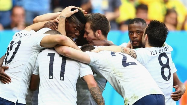 Paul Pogba of France celebrates scoring his France's first goal with his teammates during their 2014 World Cup match against Nigeria.