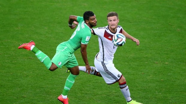 El Arbi Hillel Soudani of Algeria, left, challenges Shkodran Mustafi of Germany during the teams' FIFA World Cup Round of 16 match.