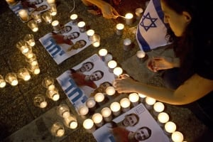 Israel teen mourning candlelight vigil