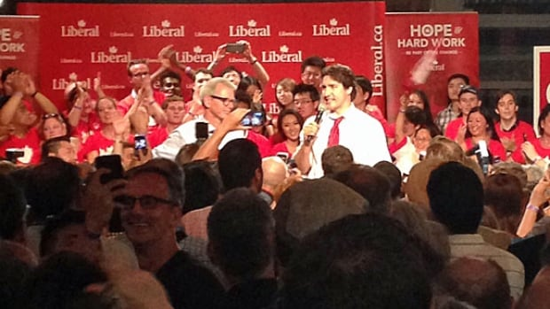 Liberal Leader Justin Trudeau, right, speaks to Liberal supporters in Toronto's Trinity-Spadina riding celebrating the election of Adam Vaughan, left, in Monday's byelection. The Liberals won two seats in Toronto, while the Conservatives won seats in Alberta.