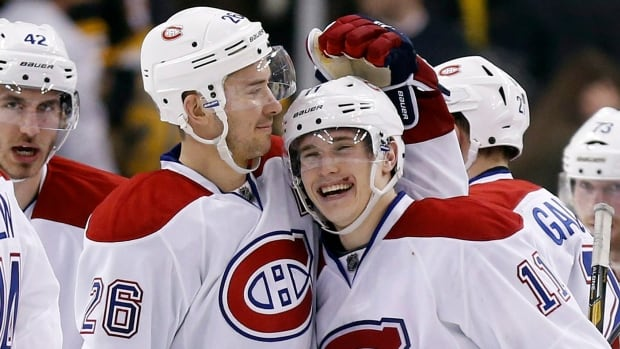 Defenceman Josh Gorges, left, was traded by the Montreal Canadiens on Tuesday. Gorges and his former teammate Brendan Gallagher were quick to tweet their thoughts on the deal.