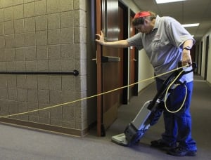 A woman vacuums a building in Rapid City, S.D.