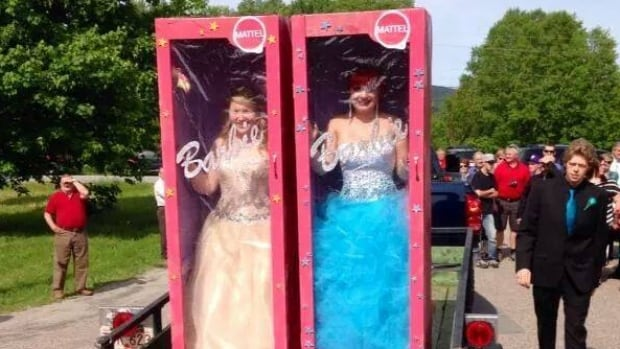 Alyssa Vincent, left, and Paige Downton showed up to their high school graduation in Pasadena inside homemade Barbie boxes.