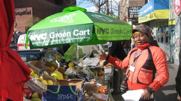 A vendor with her fresh produce for sale in New York City.