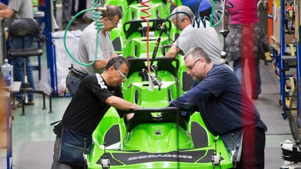 Employees work on the SeaDoo assembly line at the Bombardier Recreational Products plant in Valcourt, Que. The June survey of Canadian manufacturers shows a rebound in output and new orders.