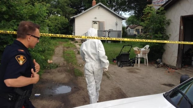 Police at the scene of the city's fourth murder.