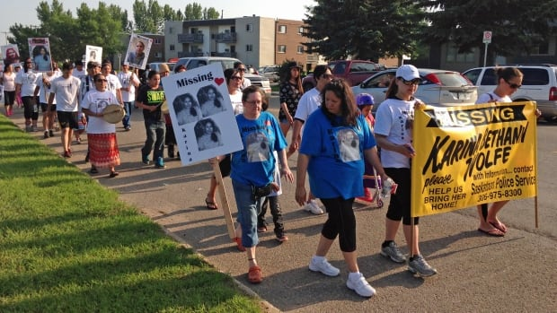 Dozens of Karina Wolfe's family and supporters walked together to remember her.