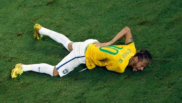 Neymar grimaces in pain after the Brazilian striker was injured late in the team's quarter-final match against Colombia at the FIFA World Cup.