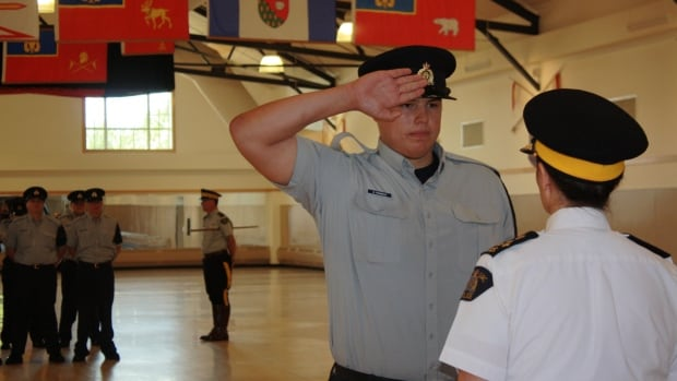 A successful member of the Aboriginal Pre-Cadet Training Program salutes during the troop's graduation ceremony Friday.