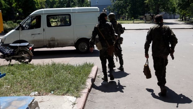Pro-Russian rebels pull out of a flashpoint area of eastern Ukraine on Saturday as authorities in Kyiv savoured a major military success in its three-month fight against the separatists.