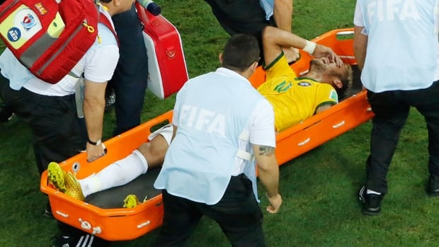 Brazilian striker Neymar is taken off the pitch on a stretcher after a challenge against Colombia on Friday.