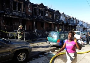 APTOPIX Fatal Row House FIre