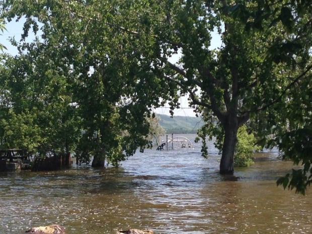 Campground and flooded play structure at Round Lake
