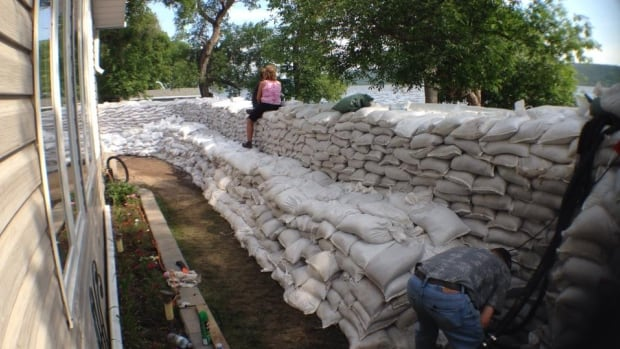 Lindsey Berthelet took this photo July 4, 2014 after four days of sandbagging around a friend's home at Round Lake. She said by the next afternoon, the water reached approximately halfway up the outside wall of sandbags.