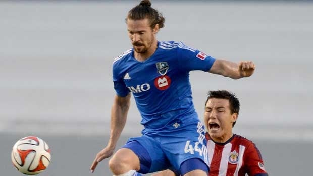 Montreal Impact defender Heath Pearce leaps for the ball in the first half of Saturday's match in front of Erick Torres of Chivas, who would go on to burn the visitors.