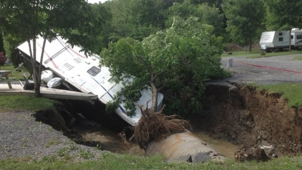 A trailer was stuck in a sinkhole at the Hartt Island RV Resort in Fredericton on Sunday.