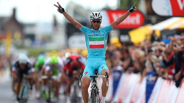 Vincenzo Nibali of Italy and ProTeam Astana crosses the line to win the second stage of the 2014 Tour de France, a 201-kilometre stage between York and Sheffield, England, on  Sunday.