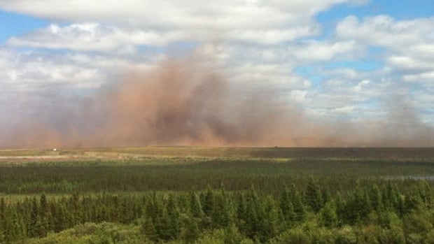 A cloud of brown dust blowing into western Labrador from the idled Wabush Mines operation.