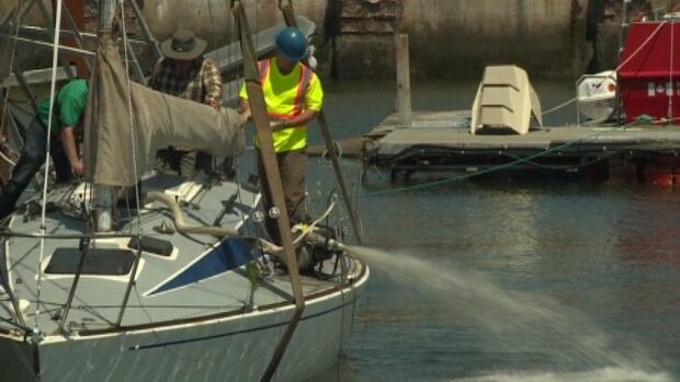 This sailboat, called Surprise, was removed from Charlottetown harbour on Sunday. It sank when post-tropical storm Arthur blew in on Saturday.