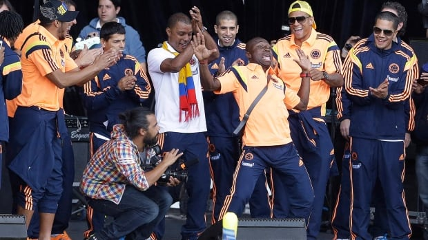 Colombia's soccer player Pablo Armero, third right, dances as teammates watch during the team's homecoming celebration in honour of their World Cup showing, in Bogota, Colombia, on Sunday.