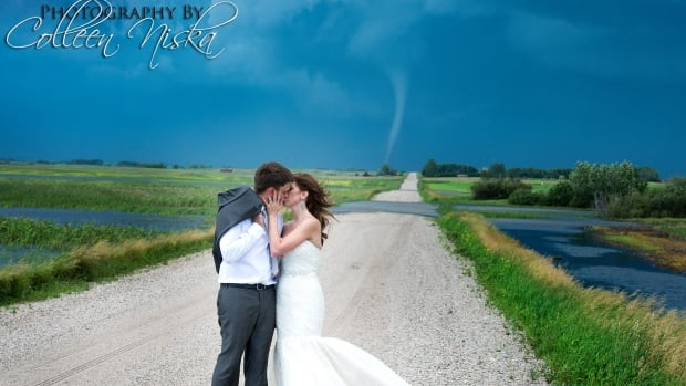 Professional photographer Colleen Niska was snapping photos of a newly married couple on Saturday when a tornado formed behind the posing love birds. She decided to keep snapping, and the resulting images have gone viral.