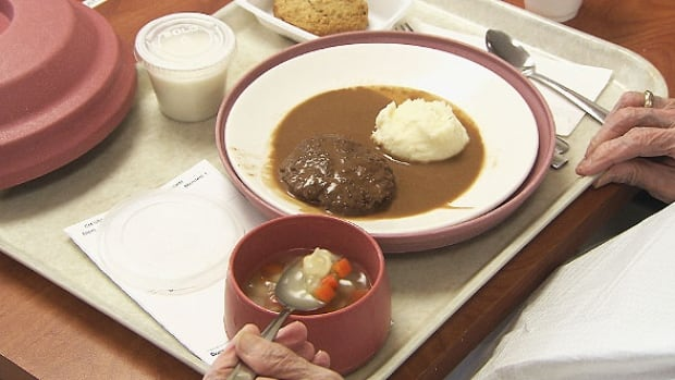 A patient eats a meal at a Quebec seniors' residence.