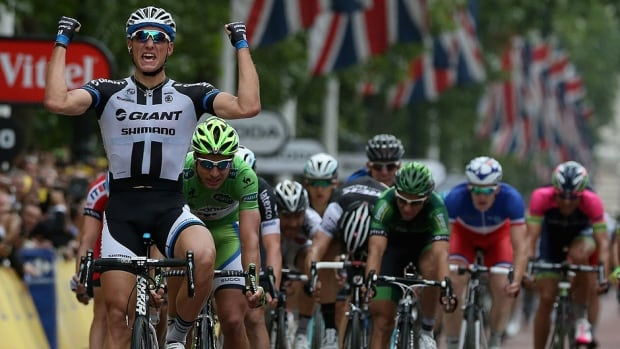 Marcel Kittel of Germany and Team Giant-Shimano celebrates as he wins the third stage of the Tour de France from Cambridge to London, England on Monday.  Italy's Vincenzo Nibali retains the overall leader's yellow jersey with a two-second advantage.